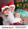 happy family near Christmas tree at home - stock photo