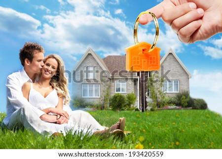 Happy family near new home. Mortgage concept. - stock photo