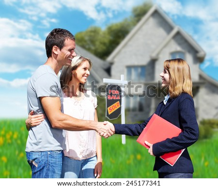 Happy Family near new home. Residential construction background. - stock photo