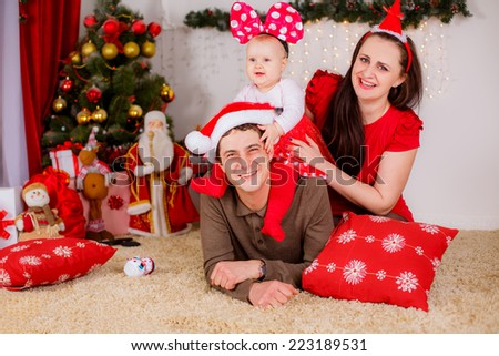 happy family near the Christmas tree. Red concept shooting, christmas - stock photo