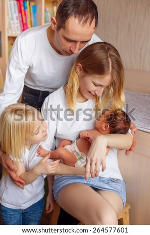 happy family. newborn baby in the arms of mother - stock photo