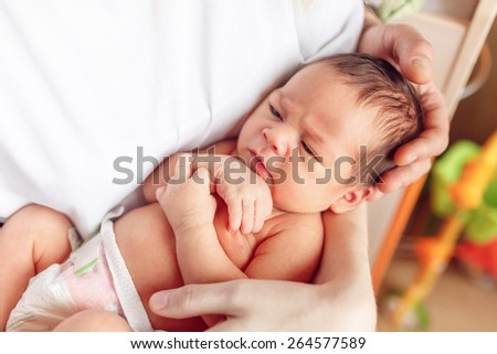 happy family. newborn baby in the arms of my mother, close-up - stock photo