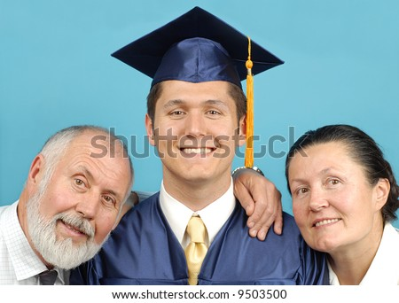 Happy family of a graduate with their pride and joy - stock photo