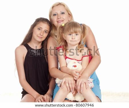 happy family of a three on a carpet - stock photo