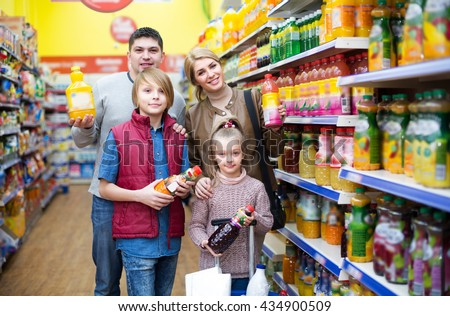 Happy family of customers with children purchasing carbonated beverages in store