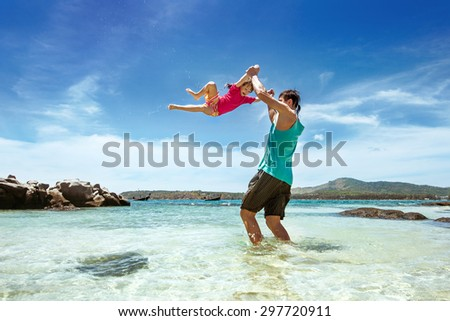 Happy family of father and daughter having fun on the beach - stock photo