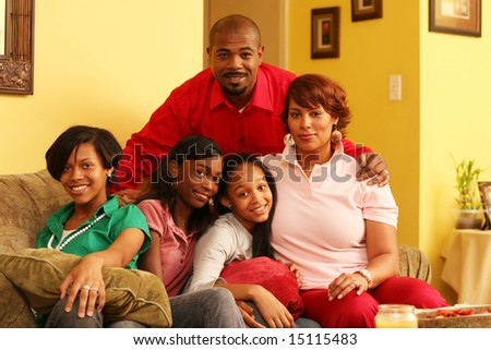 Happy family of five together at home - stock photo
