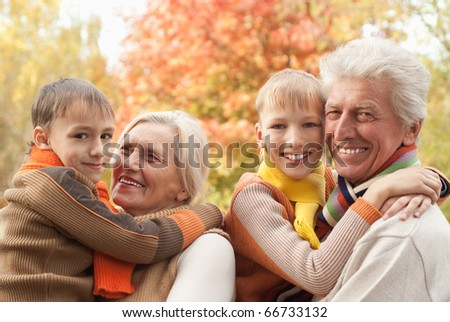 happy family of four in a park