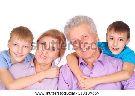 happy family of four on a light background
