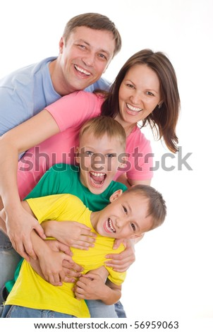 happy family of four on a white