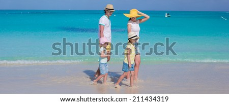 Happy family of four on caribbean holiday vacation