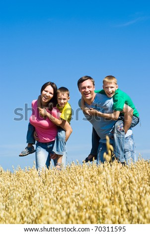 happy family of four on the nature - stock photo
