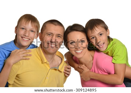 Happy family of four on white background - stock photo