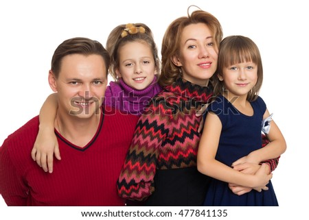 Happy family of four. Parents with their wonderful girls - Isolated on white background
