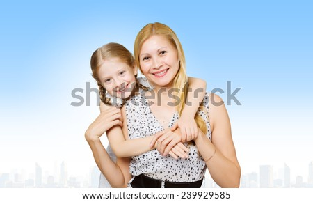 Happy family of smiling mother and daughter - stock photo