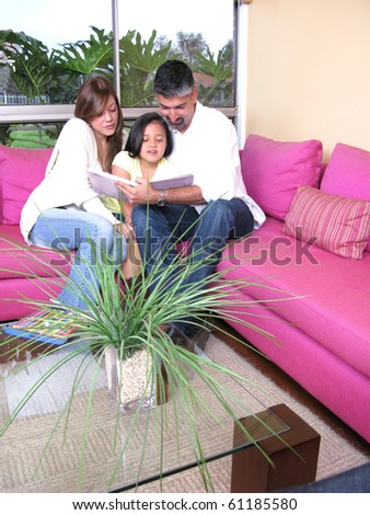 Happy family of the house on a sofa - stock photo