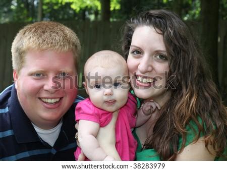 Happy Family of Three - Couple with Baby - stock photo
