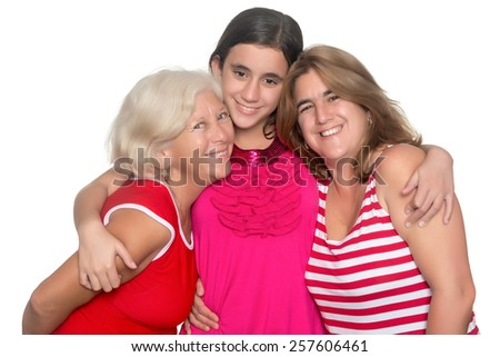 Happy family of three generations of hispanic women isolated on white - stock photo