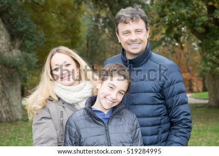 Happy family of three having fun together outdoor.
