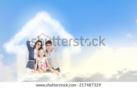 Happy family of three lying on white cloud - stock photo