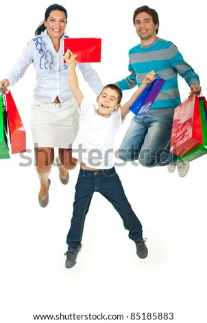Happy family of three members jumping and holding shopping bags isolated on white background - stock photo