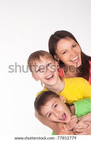 happy family of three on a white