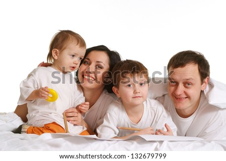 happy family of three on the bed