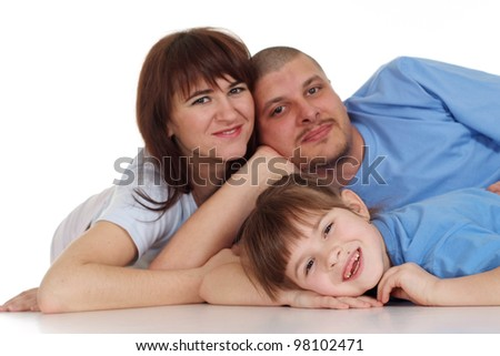 Happy family of three people lying on isolate background