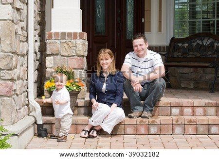 Happy Family of Three Smiling - stock photo
