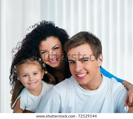 Happy family  on a blue background - stock photo