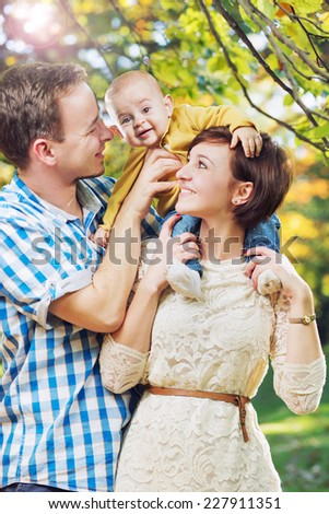 Happy family on a fall day - stock photo