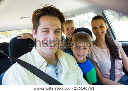 Happy family on a road trip on a sunny day - stock photo