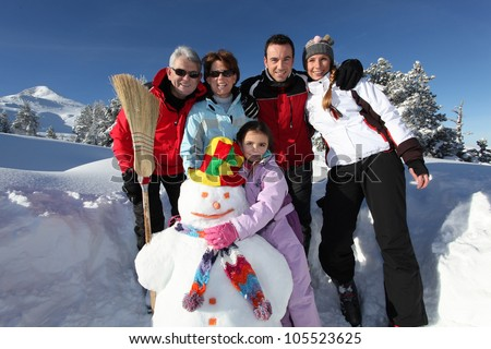 happy family on a winter vacation - stock photo
