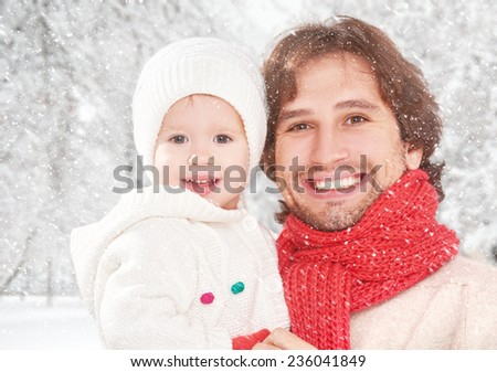 happy family on a winter walk, father and child baby daughter outdoors in winter - stock photo