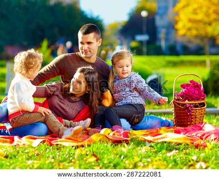 happy family on autumn picnic in park - stock photo