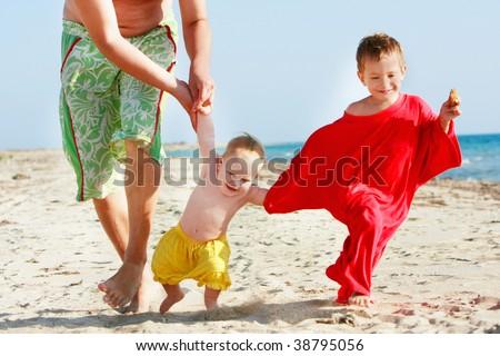 happy family on beach - stock photo