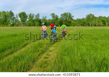 Happy family on bikes, spring cycling ourdoors with kids