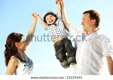 happy family on blue sk - stock photo