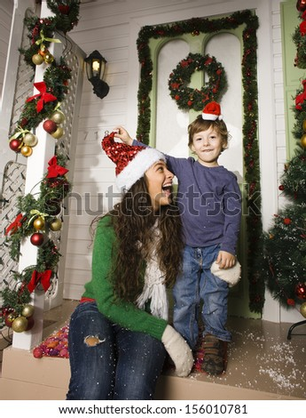 happy family on Christmas in red hats - stock photo