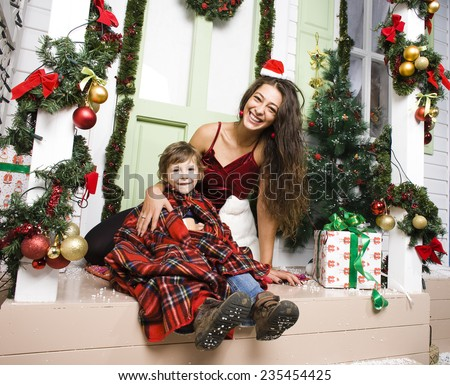 happy family on Christmas in red hats waiting gests and smiling at home - stock photo
