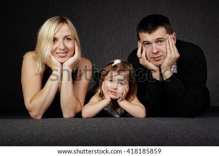 happy family on dark background - stock photo