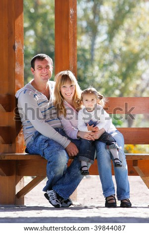 happy family on natural background - stock photo