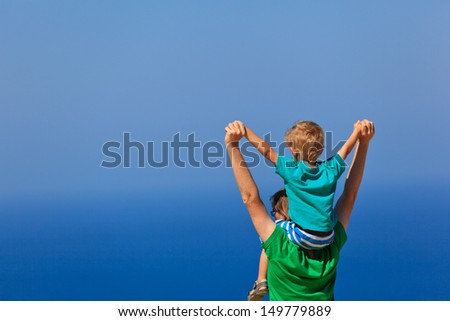 happy family on sea vacation with the sky on background