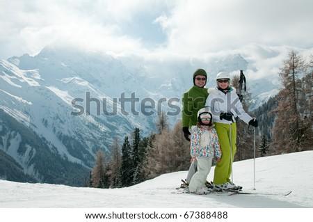 Happy family on ski - stock photo