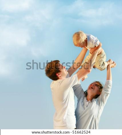 happy family on sky background - stock photo