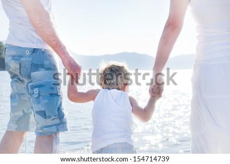 Happy family on the beach. Photo behind - stock photo
