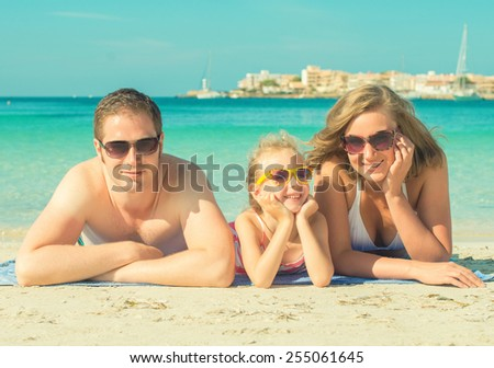 Happy family on the beach vacation. - stock photo