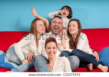happy family on the couch in the living room