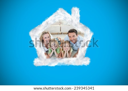Happy family on the floor against blue background with vignette - stock photo