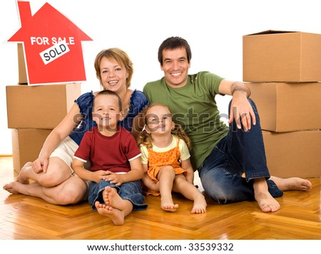 Happy family on the floor with cardboard boxes moving in their new home - isolated - stock photo